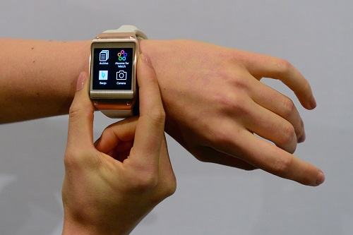"""The functions of Samsung's Galaxy Gear smartwatch is displayed at the IFA (Internationale Funkausstellung) electronics trade fair in Berlin on September 4, 2013.  The South Korean electronics giant believes its Galaxy Gear watch will """"lead a new trend in smart mobile communications. AFP PHOTO / JOHN MACDOUGALLJOHN MACDOUGALL/AFP/Getty Images"""